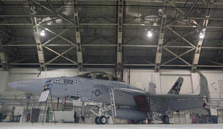 A F/A 18 E/F Super Hornet fighter jet is seen in its hanger during ceremonies celebrating the 35th anniversary of the F/A18 Hornet fighter jet at Naval Air Station Patuxent River Maryland December 9, 2013. REUTERS/Gary Cameron