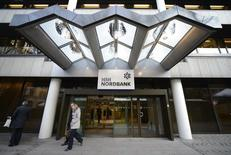 People leave the HSH Nordbank building in downtown Hamburg, December 7, 2012. REUTERS/Fabian Bimmer