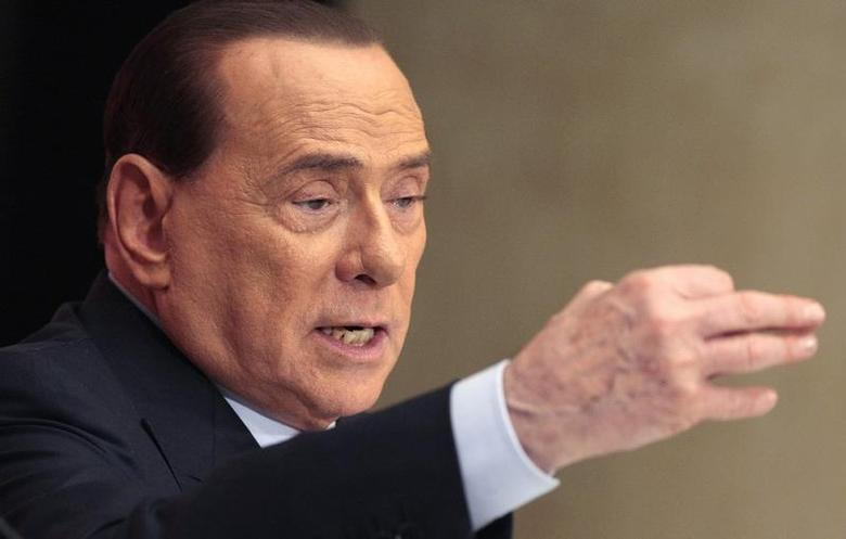 Former Italian Prime Minister Silvio Berlusconi gestures as he attends the launch of the book ''Sale, zucchero e caffe''' (Salt, Sugar and Coffee) by journalist Bruno Vespa, in downtown Rome December 4, 2013. REUTERS/Remo Casilli
