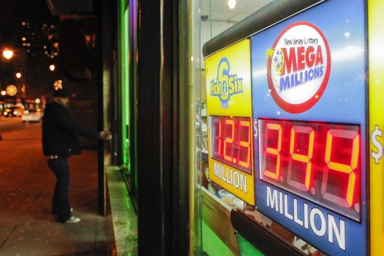 A customer arrives at a store where a Mega Millions sign is seen after the lottery grand prize rose to $344 million in New York December 7, 2013. REUTERS/Eduardo Munoz