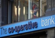 A Union Jack is reflected in a window of a branch of the Co-operative Bank in the City of London November 4, 2013. REUTERS/Andrew Winning