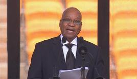South African President Jacob Zuma makes a speech in this still image taken from video courtesy of the South Africa Broadcasting Corporation (SABC) at the First National Bank (FNB) Stadium, also known as Soccer City, during former South African President Nelson Mandela's national memorial service in Johannesburg December 10, 2013. REUTERS/SABC via Reuters TV