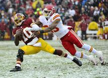 Dec 8, 2013; Landover, MD, USA; Washington Redskins quarterback Robert Griffin III (10) is tackled by Kansas City Chiefs safety Eric Berry (29) during the second quarter at FedEx Field. Brad Mills-USA TODAY Sports