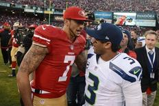 San Francisco 49ers quarterback Colin Kaepernick (7) shakes hands with Seattle Seahawks quarterback Russell Wilson (3) after the game at Candlestick Park. Kyle Terada-USA TODAY