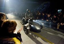 """Bombardier Recreational Products Inc. (BRP) introduced its first """"on-road"""" vehicle, the 2008 Can-Am Spyder roadster in front of employees in Valcourt, Quebec February 5, 2007. REUTERS/Christinne Muschi"""