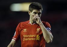 Liverpool's Steven Gerrard wipes his face during their English Premier League soccer match against West Ham United at Anfield in Liverpool, northern England December 7, 2013. REUTERS/Phil Noble