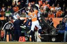 Dec 12, 2013; Denver, CO, USA; San Diego Chargers wide receiver Keenan Allen (13) scores his second touchdown in front of Denver Broncos cornerback Kayvon Webster (36) in the second quarter at Sports Authority Field at Mile High. Mandatory Credit: Ron Chenoy-USA TODAY Sports