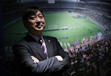 President of the professional soccer club Sanfrecce Hiroshima, Kaoru Koyano, poses for a photo at the Japan Football Museum in Tokyo December 11, 2013. REUTERS/Toru Hanai