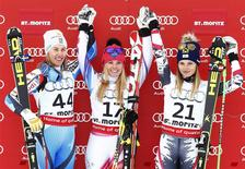 First placed Tina Weirather of Liechtenstein (C), second placed Kajsa Kling of Sweden (L) and third placed Anna Fenninger of Austria pose on the podium after the Super-G race at the women's Alpine skiing World Cup competition at the Corviglia in the Swiss mountain resort of St. Moritz December 14, 2013. REUTERS/Arnd Wiegmann