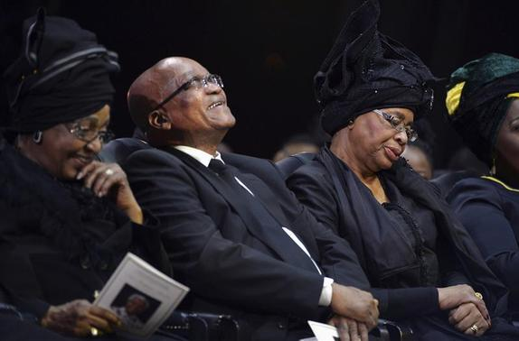 South Africa's President Jacob Zuma (C), Winnie Mandela (L), ex-wife of former South African President Nelson Mandela, and Graca Machel (R), widow of Mandela, attend Nelson Mandela's funeral ceremony in Qunu December 15, 2013. REUTERS-Odd Andersen-Pool