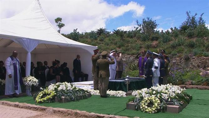 Military personnel salute after the burial of former South African President Nelson Mandela in his ancestral village of Qunu in the Eastern Cape province, 900 km (559 miles) south of Johannesburg, in this still image taken from December 15, 2013 video courtesy of the South Africa Broadcasting Corporation (SABC). REUTERS-SABC via Reuters TV