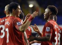Liverpool's Luis Suarez (L) and Raheem Sterling celebrates after scoring a goal during their English Premier League soccer match against Tottenham Hotspur at White Hart Lane in London December 15, 2013. REUTERS/Toby Melville