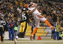 Dec 15, 2013; Pittsburgh, PA, USA; Cincinnati Bengals tight end Tyler Eifert (right) catches a touchdown pass against Pittsburgh Steelers free safety Ryan Clark (25) during the fourth quarter at Heinz Field. The Steelers won 30-20. Mandatory Credit: Charles LeClaire-USA TODAY Sports