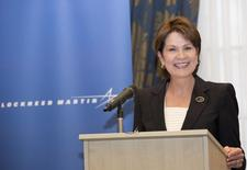 Chief Executive Officer and President of Lockheed Martin Corporation Marillyn A. Hewson speaks at a news conference in London, July 1, 2013. REUTERS/Neil Hall