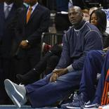 Charlotte Bobcats owner Michael Jordan watches as his team plays against the Chicago Bulls during the first half of their NBA basketball game in Charlotte, North Carolina February 22, 2013. REUTERS/Chris Keane
