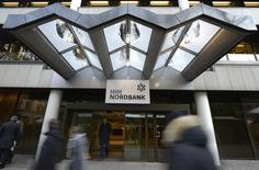 People pass the HSH Nordbank building in downtown Hamburg, December 7, 2012. REUTERS/Fabian Bimmer