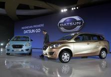 Datsun Chief Executive Carlos Ghosn walks during launch Datsun GO in Jakarta, September 17, 2013. REUTERS/Supri
