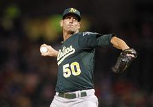 Oakland Athletics' Grant Balfour pitches against the Texas Rangers in the ninth inning of their MLB American League baseball game in Arlington, Texas June 18, 2013. REUTERS/Mike Stone
