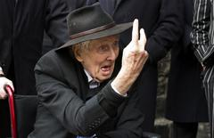 File photograph shows Great Train Robber Ronnie Biggs gesturing as he arrives for the funeral of Bruce Reynolds, at the church of St Bartholomew the Great in London March 20, 2013. REUTERS/Neil Hall/Files
