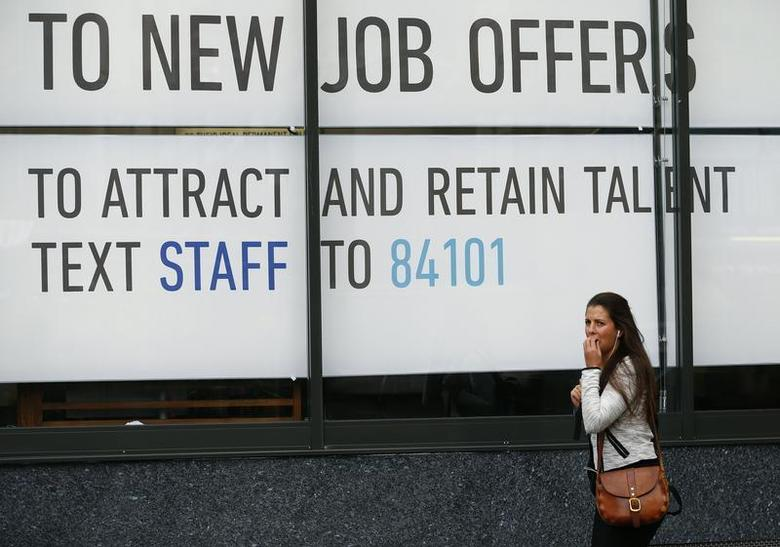 A woman walks past a recruitment agency in central London September 11, 2013. REUTERS/Andrew Winning