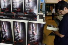 """A customer browses a copy of Swedish author Stieg Larsson's latest book,""""The Girl Who Kicked the Hornets' Nest"""", at a Madrid bookstore June 18, 2009. REUTERS/Susana Vera"""