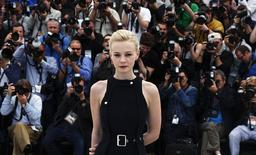 Cast member Carey Mulligan poses during a photocall for the film 'Inside Llewyn Davis' at the 66th Cannes Film Festival in Cannes May 19, 2013. REUTERS/Eric Gaillard