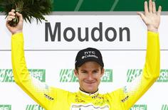 HTC Columbia's team rider Michael Rogers of Australia celebrates on the podium after wearing the leader's jersey during the third and time trial stage of the Tour de Romandie cycling race in Moudon April 30, 2010. REUTERS/Valentin Flauraud