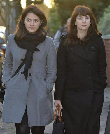 Sisters Francesca (R) and Elisabetta Grillo arrive at Isleworth Crown Court in west London December 19, 2013. REUTERS/Toby Melville