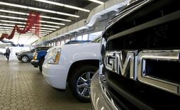 Vehicles are seen in a General Motors dealership in Montreal May 20, 2009. REUTERS/Christinne Muschi