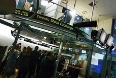 People attend a market open ceremony for the Toronto Stock Exchange at the TSX Broadcast Centre in Toronto June 20, 2008. REUTERS/Mark Blinch