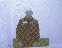El ex magnate petrolero ruso Mikhail Khodorkovsky en una pantalla en la Corte Suprema de Rusia en Moscú, ago 6 2013. Khodorkovsky fue liberado el viernes luego de una amnistía del presidente Vladimir Putin y voló a Berlín, tras 10 años en prisión que muchos interpretaron como el castigo por sus ambición de llegar al Kremlin. REUTERS/Maxim Shemetov