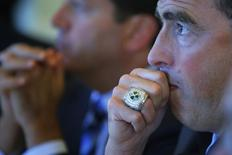 """Wycliffe """"Wyc"""" Grousbeck, CEO of the NBA's Boston Celtics, listens as Yorihiko Kojima, chairman of the board of Mitsubishi Corporation, speaks at the Boston College Chief Executives' Club of Boston luncheon in Boston, Massachusetts September 25, 2013. REUTERS/Brian Snyder"""