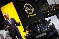 Karl-Thomas Neumann, CEO of Adam Opel AG, presents the new Opel Insignia car during a media preview day at the Frankfurt Motor Show (IAA) September 10, 2013. REUTERS/Kai Pfaffenbach