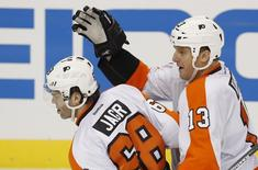 Philadelphia Flyers Jaromir Jagr (L) is congratulated by teammate Pavel Kubina after he scored the game winning goal against the Pittsburgh Penguins during the third period of Game 2 of their NHL Eastern Conference quarter-final hockey game in Pittsburgh, Pennsylvania April 13, 2012. REUTERS/Jason Cohn