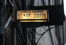 The stage door light is seen at the back of the Apollo theatre on the morning after part of it's ceiling collapsed on spectators as they watched a performance, in central London, December 20, 2013. REUTERS/Suzanne Plunkett