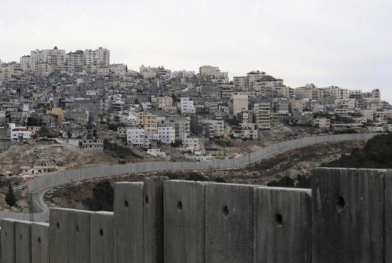 Israel's controversial barrier runs along the Shuafat refugee camp in the West Bank near Jerusalem November 23, 2013. REUTERS/Ammar Awad