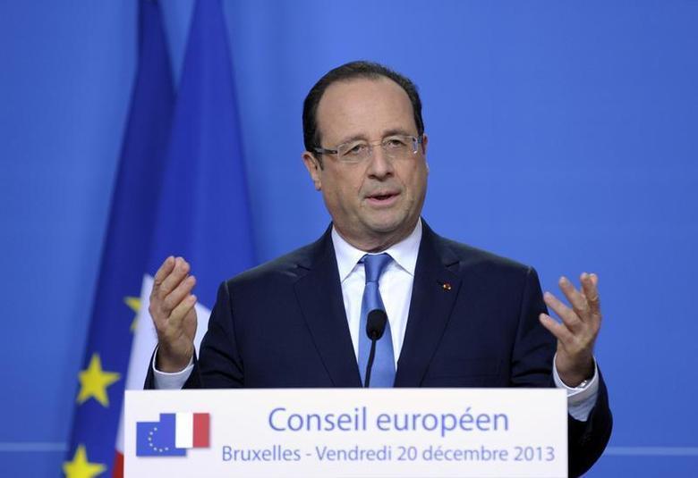 France's President Francois Hollande addresses a news conference during a European Union leaders summit in Brussels December 20, 2013. REUTERS/Laurent Dubrule