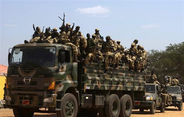 SPLA soldiers drive in a truck in Juba December 21, 2013. REUTERS/Stringer
