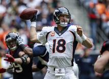 Dec 22, 2013; Houston, TX, USA; Denver Broncos quarterback Peyton Manning (18) attempts a pass during the second quarter against the Houston Texans at Reliant Stadium. Mandatory Credit: Troy Taormina-USA TODAY Sports