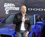 """Cast member and producer Vin Diesel poses at the premiere of the new film, """"Fast & Furious 6"""" at Universal Citywalk in Los Angeles May 21, 2013. REUTERS/Fred Prouser"""