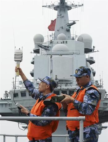 Chinese naval soldiers monitor meteorological indicators on the aircraft carrier ''Liaoning'', as they carry out training in South China Sea, December 22, 2013. REUTERS/China Daily