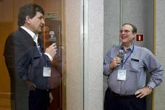 U.S. entrepreneur Charles Simonyi (L) meets his friend, Microsoft co-founder Paul Allen at the Baikonur cosmodrome March 25, 2009. REUTERS/Shamil Zhumatov