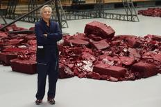 """Indian-born British artist Anish Kapoor poses in front of his art work 'Symphony for a Beloved Sun"""" (2013) during a media preview of the exhibtion 'Kapoor in Berlin' at the Martin-Gropius Bau, in Berlin May 17, 2013. REUTERS/Philippe Wojazer"""