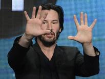 """Host and producer Keanu Reeves participates in a panel for the documentary """"Side by Side"""" during the PBS sessions at the Television Critics Association summer press tour in Beverly Hills, California August 6, 2013. REUTERS/Phil McCarten"""