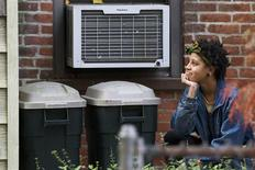 Chiara de Blasio, daughter of Democratic New York City mayoral candidate Bill de Blasio hides in the bushes of her family home waiting to surprise her father in the Park Slope section of Brooklyn in New York, in this file photo from November 5, 2013. REUTERS/Brendan McDermid