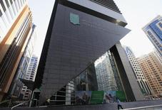A man walks past a National Bank of Abu Dhabi branch, August 27, 2012. REUTERS/Jumana El Heloueh