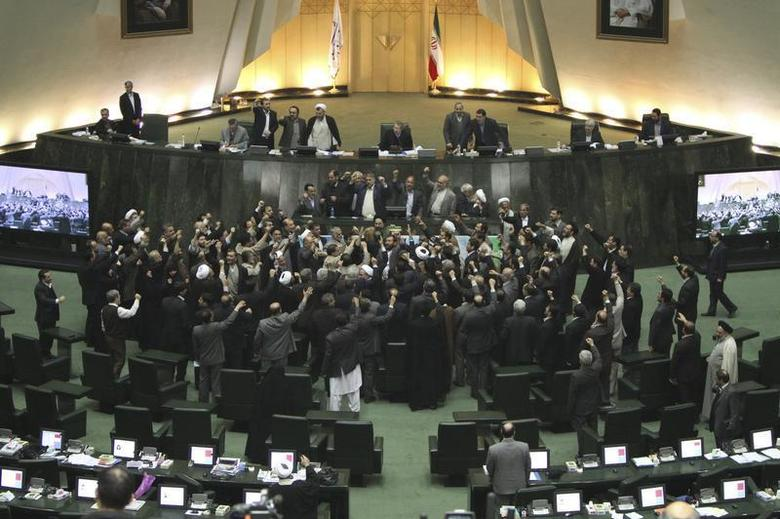 Members of the Iranian parliament shout slogans calling for the execution of opposition leaders before the start of their session in Tehran February 15, 2011. REUTERS/Raouf Mohseni/Mehr News/Handout