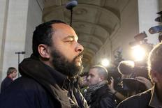 "French humorist Dieudonne M'bala M'bala (L), also known as Dieudonne, arrives for the start of the trial of Ilich Ramirez Sanchez, known as ""Carlos the Jackal"", at Paris' special court November 7, 2011. REUTERS/Charles Platiau"