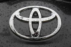 The Toyota logo is seen on a car at a Japan's Toyota Motor Corp car dealership in Hoenheim near Strasbourg, eastern France October 10, 2012. REUTERS/Vincent Kessler