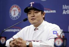 Texas Rangers outfielder Shin-Soo Choo talks to the media after being introduced at a press conference at Texas Rangers Ballpark. Mandatory Credit: Tim Heitman-USA TODAY Sports